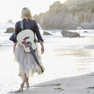 Woman On the Beach with Guitar